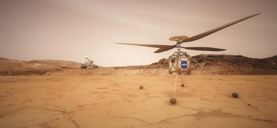 Graphical representation: On the reddish surface of Mars, a small robotic helicopter is on the ground in the foreground with the Nasa logo on its front. In the distance is a rover
