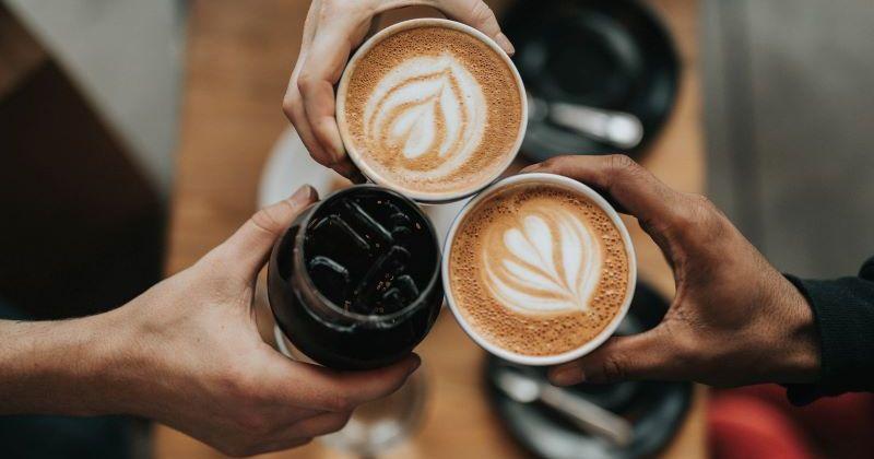 People cheersing their coffees