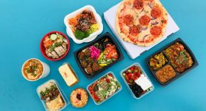 image shows a series of meal kits on a blue background