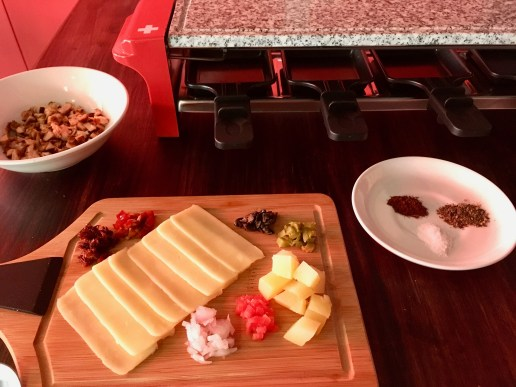 Raclette - Chicken Cheese, Pickled Sundried Tomatoes, Jalapenos, Olives, Gherkins, Raw Onions, Tomato, Potatoes and Seasonings (Salt, Pepper and Smoked Paprika) along with the Swiss Raclette Stove