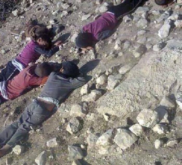 Children lie where they were killed by militants.