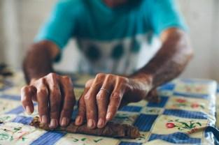 Tobacco farmer rolling a cigar in Viñales, Cuba
