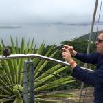Jim taking a photo of a monkey