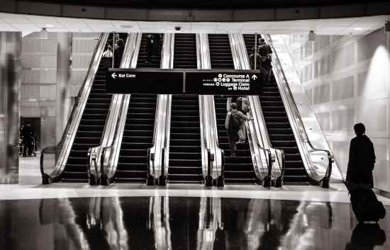 stairs-people-airport-escalators.jpg
