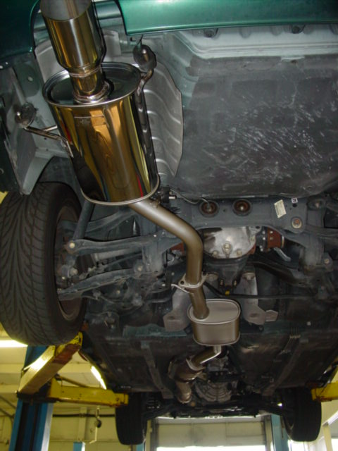With the exhaust in place, tighten all of the bolts and make sure all of the hangers are attached.