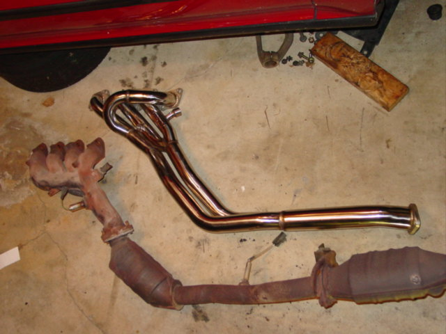 For my swap, I used an OBX header that I bought on eBay. It was $200 shipped. Other than hitting the bottom of the car, due to my Nismo mounts, it's an excellent solid stainless steel manifold.