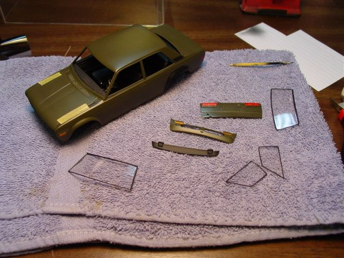 I used parafilm and painted the window trim on the car and around the glass.