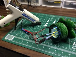 I had to use my glue gun for another project and had the idea of using it to hold the fibers. It worked perfectly!