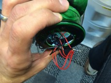 With all of the fiber and LED's comfortably sitting inside the base, it was time to solder the wires.