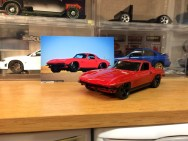 The completed 'Vette posed with a picture of its inspiration.