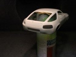 My first experiment was on a junk 928 body. The deep tail light would give me a chance to test for shrink-free filler.