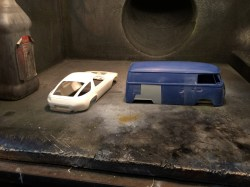 The bus and spare 928 body are primered.