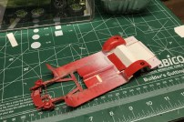 I used wheel wells from a spare kit to build deeper wells for the lower stance.