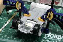 I used a mirror and clamps to hold the Chevy's chassis in place, on the business cards, to properly locate the front wheels.