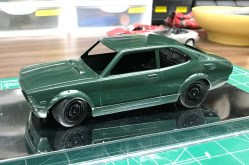 The kit is actually molded in a really nice metallic green. I would consider prepping and polishing the kit with no paint if there weren't any anomalies in the metallic's grain.