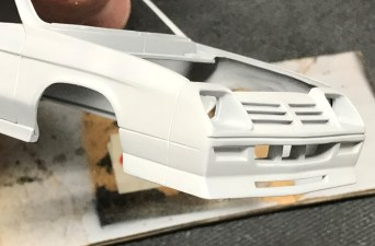 After sanding and re-scribing panel lines, I was very happy with the new character line on the charger!