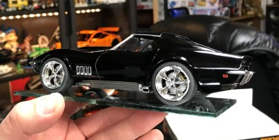 After finishing the '12 Vette, I started working on the '69 Vette. I used a combination of bare metal foil and molotow chrome to finish the gills on the fenders. I also attached the wheels and brakes.