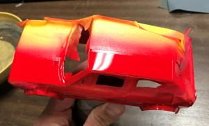 Before I sprayed the first color, I sprayed clear along the tape seams in hopes of filling in any bleeder potential with clear paint.