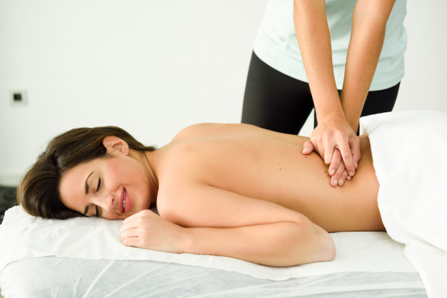 young-female-receiving-relaxing-back-massage-spa-center_1139-1229