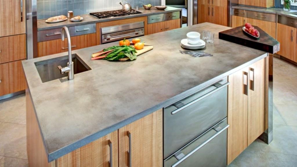 Kitchen with concrete countertop, backsplash and appliances