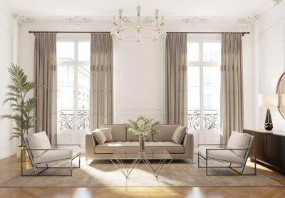 living room off white walls with ceiling height windows, beige colored draperies and a beige couch and accent chairs