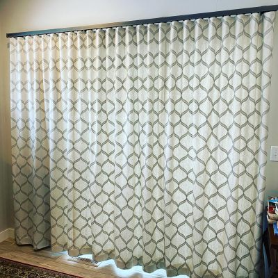 ripplefold-drapery-in-living-room-mounted-on-select-drapery-hardware.-pleated-to-pattern.-Impressive-Windows-and-Interiors.-blinds.-shades.-window-treatments.-Hastings-MN