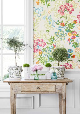 Decorative distressed wood side table with greenery- Multicolored floral wallpaper by Thibaut- Impressive Windows and Interiors- Hastings MN