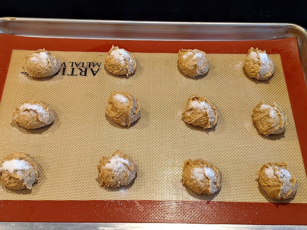 Scoop into balls with medium cookie scoop (2 tablespoon), sprinkle with sugar