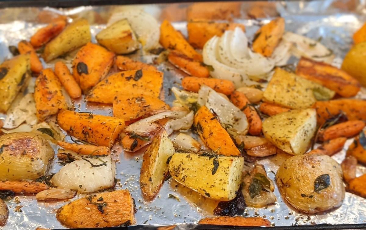 Slightly browned vegetables on baking sheet