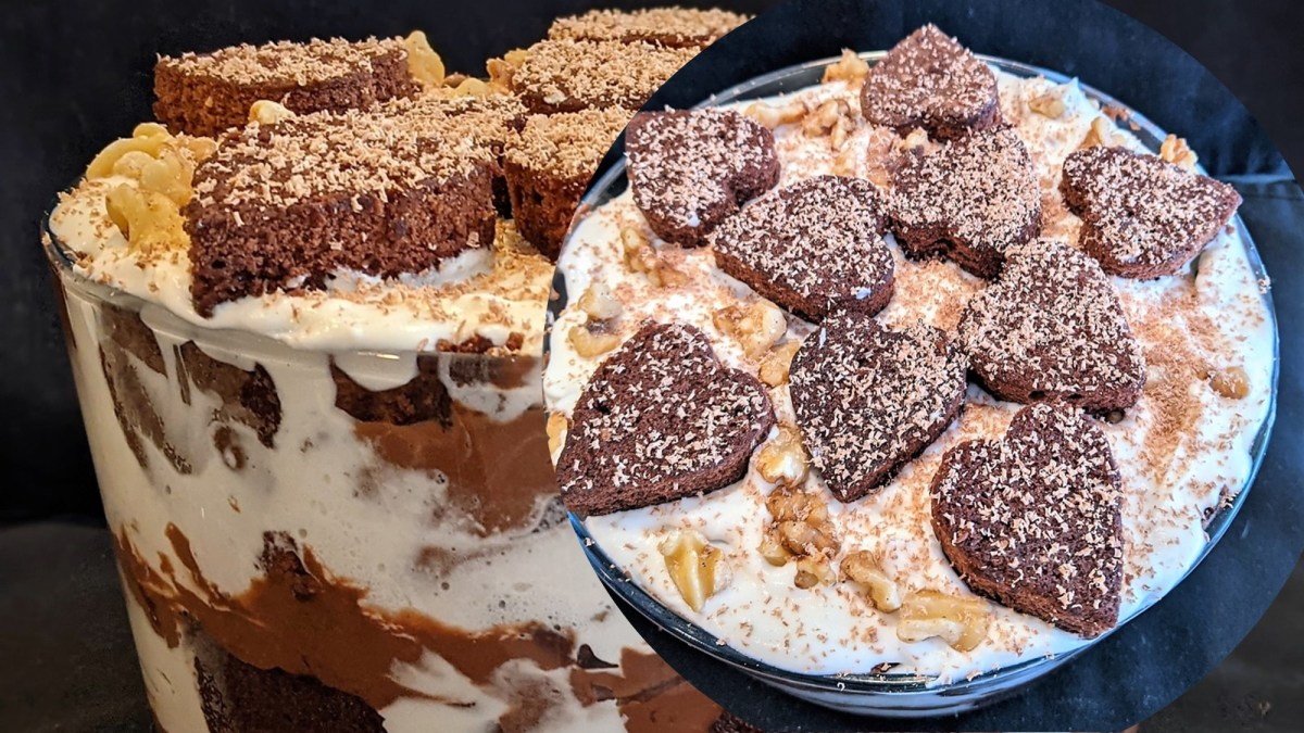 Top with the remainder of the whipped topping.  Gently place additional hearts down flat.  Garnish with shaved chocolate and remaining walnuts