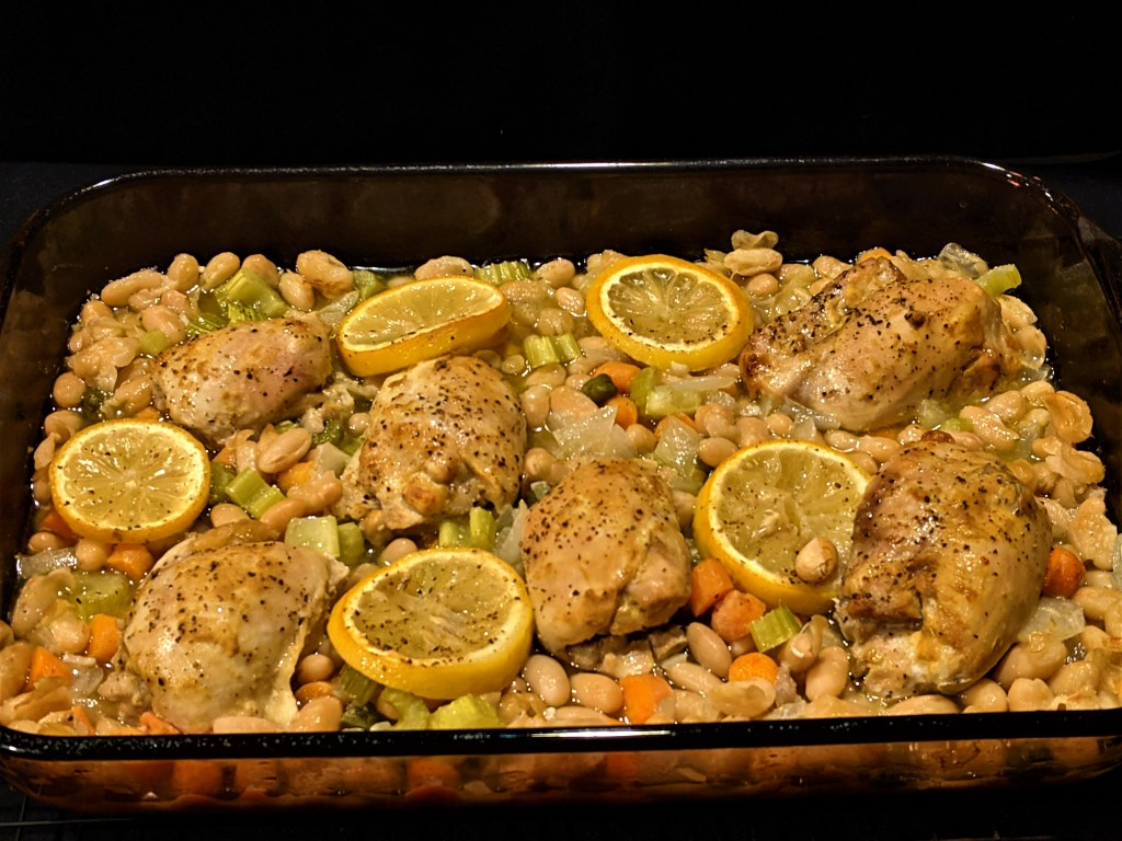 Chicken and vegetables roasting in pan