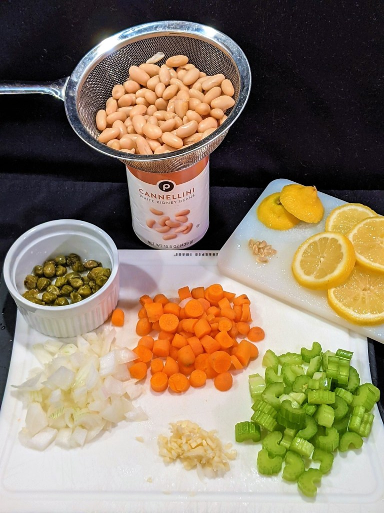 prepped vegetables: chopped onion, minced garlic, sliced carrots and celery. Measured capers
