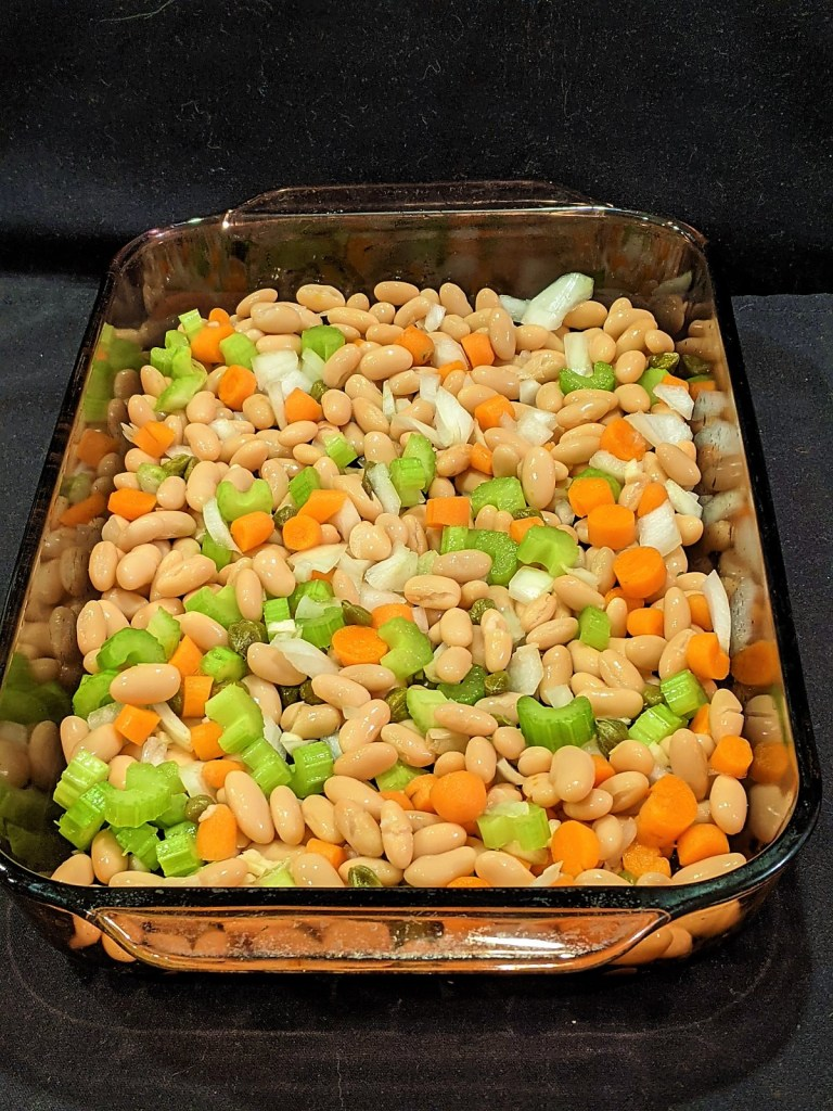 Combine beans, veggies and capers in a 9x13 baking dish