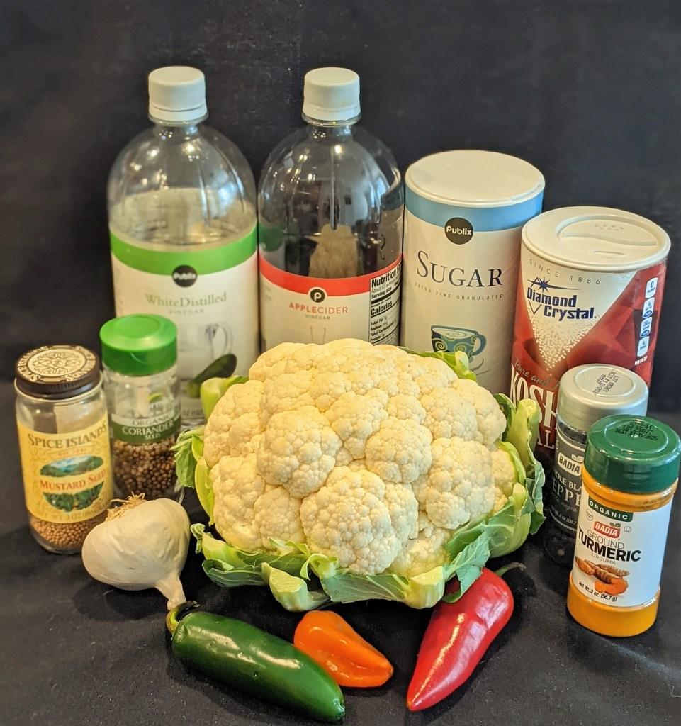 cauliflower, peppers, garlic, white vinegar, cider vinegar, sugar, salt and spices.