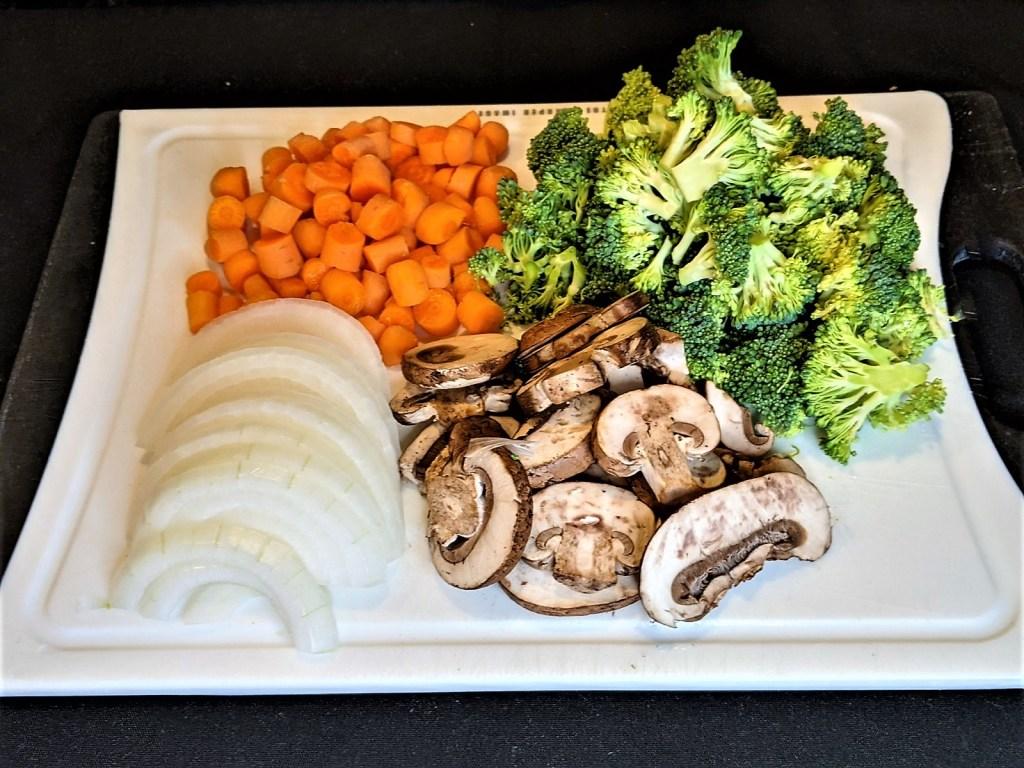 sliced onions, sliced carrots, slice mushrooms and broccoli florets