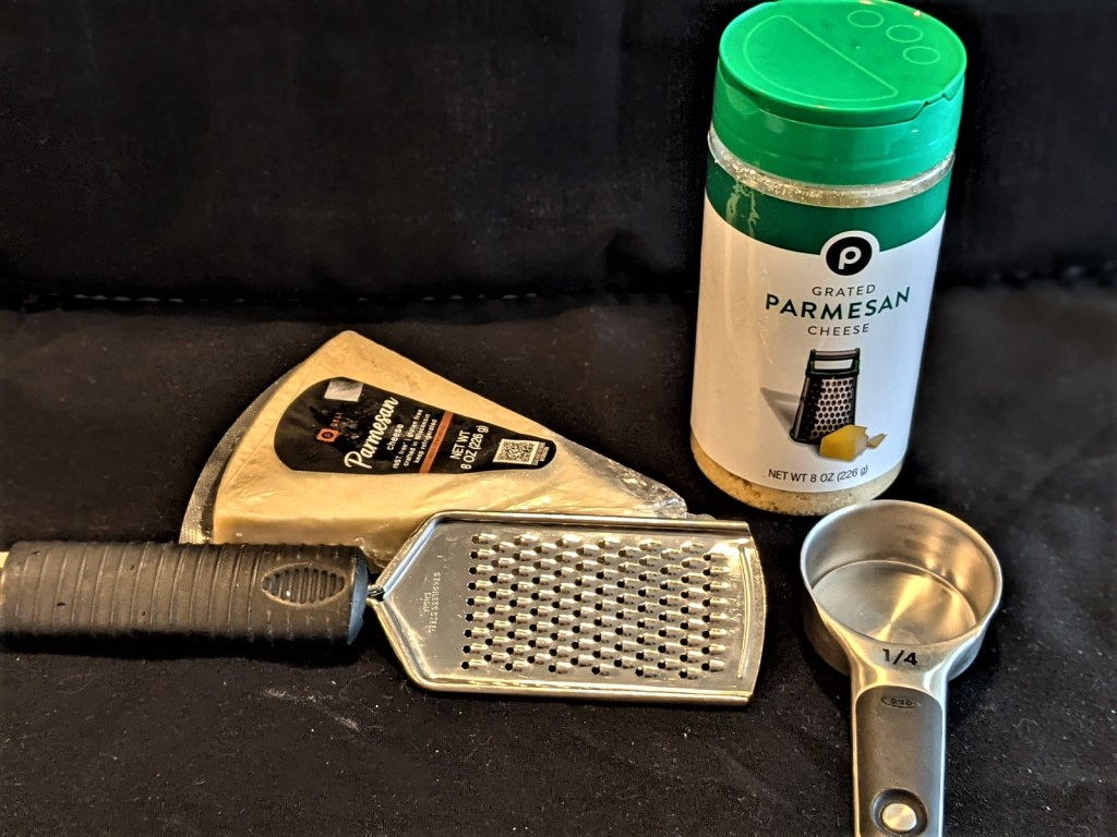 picture of fresh cheese and canned cheese with grater and measuring cup