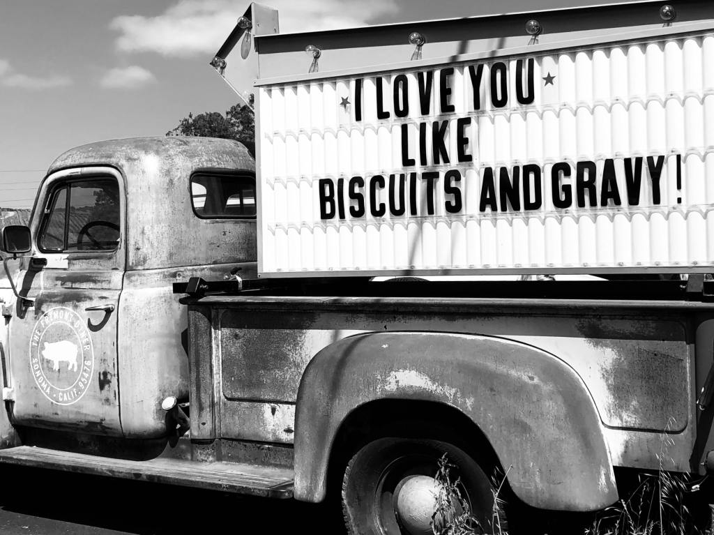 vintage photo of truck with biscuits and gravy signs