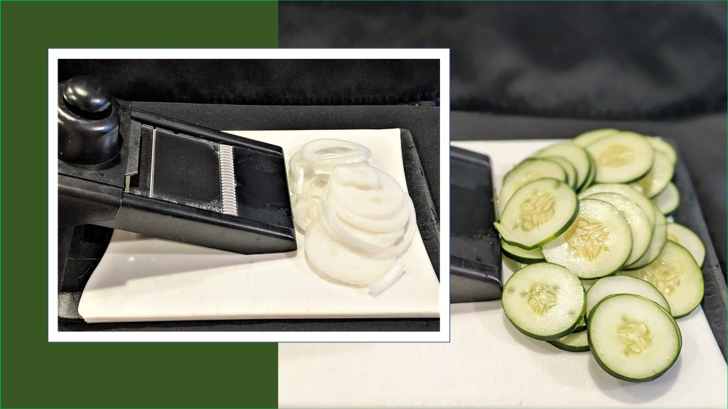 mandolin slicer with sliced onion and cucumber.