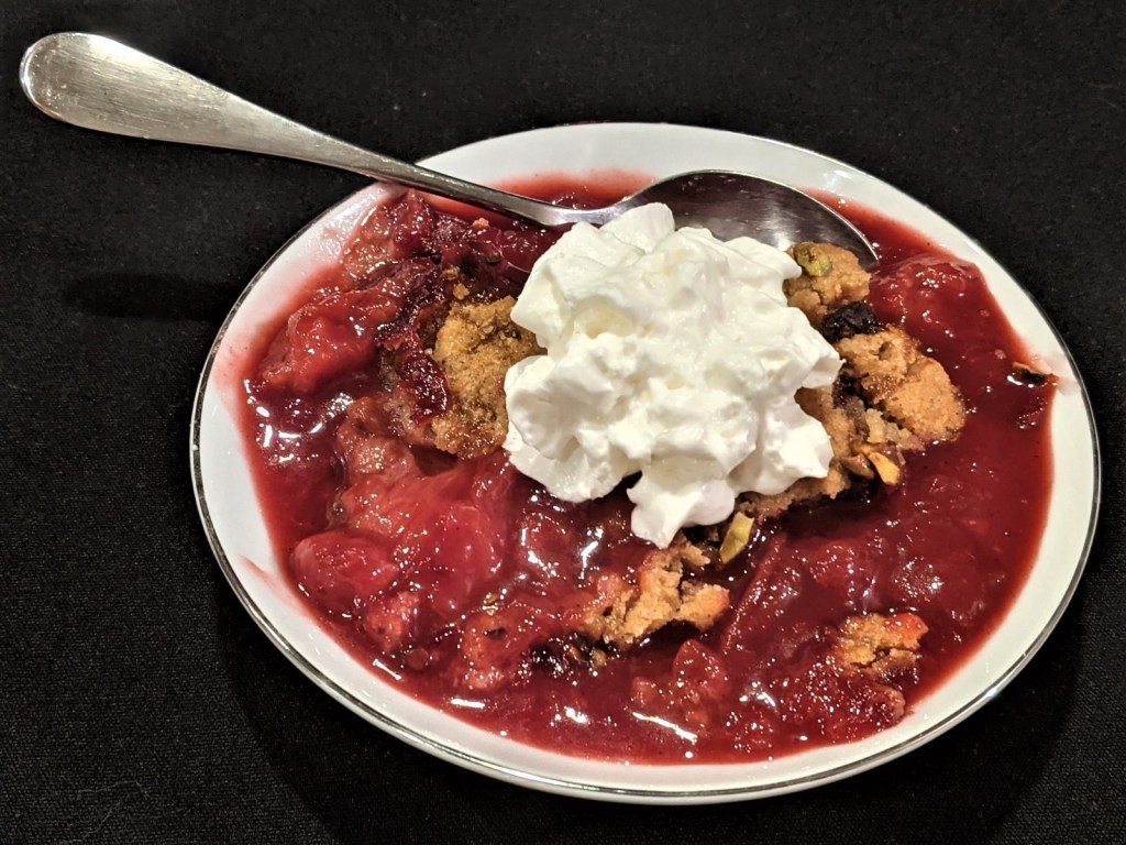Bowl with crumble and whipped topping