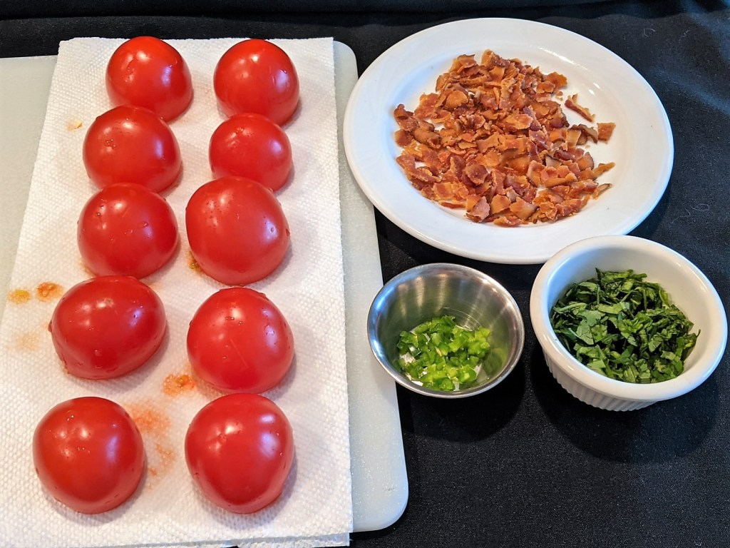 hollowed tomatoes, bacon, peppers and basil.