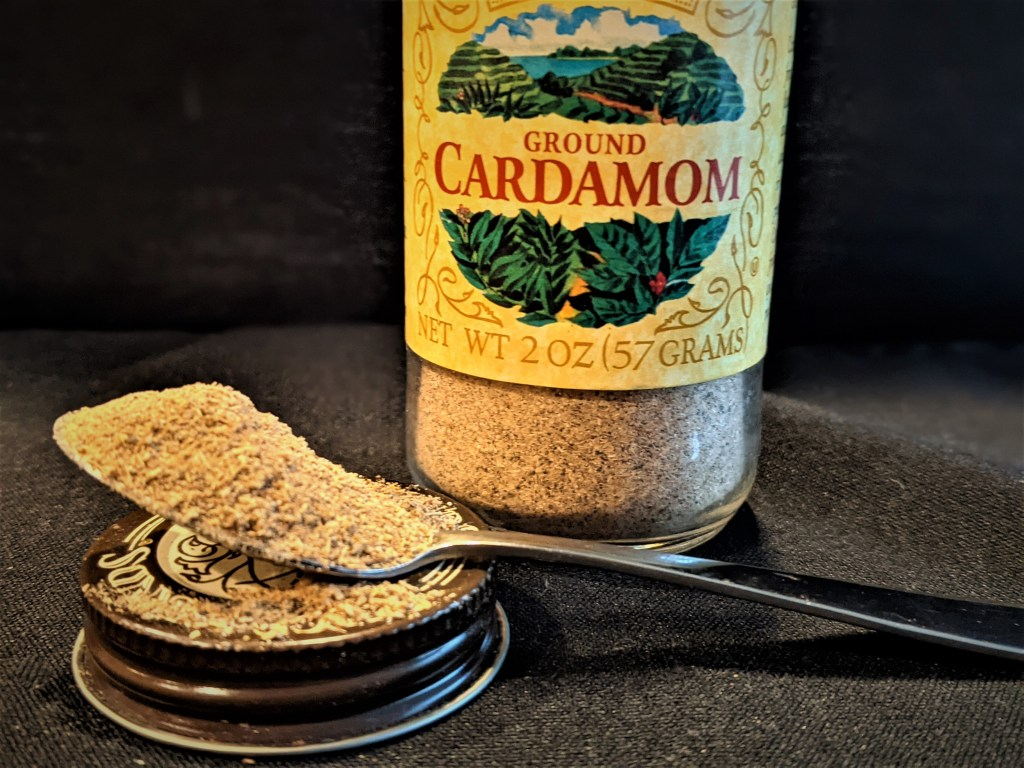 jar and spoon of cardamom