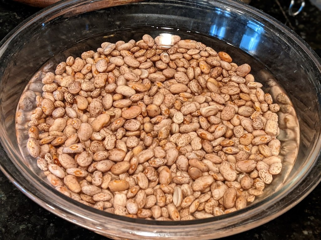 beans soaking in a bowl