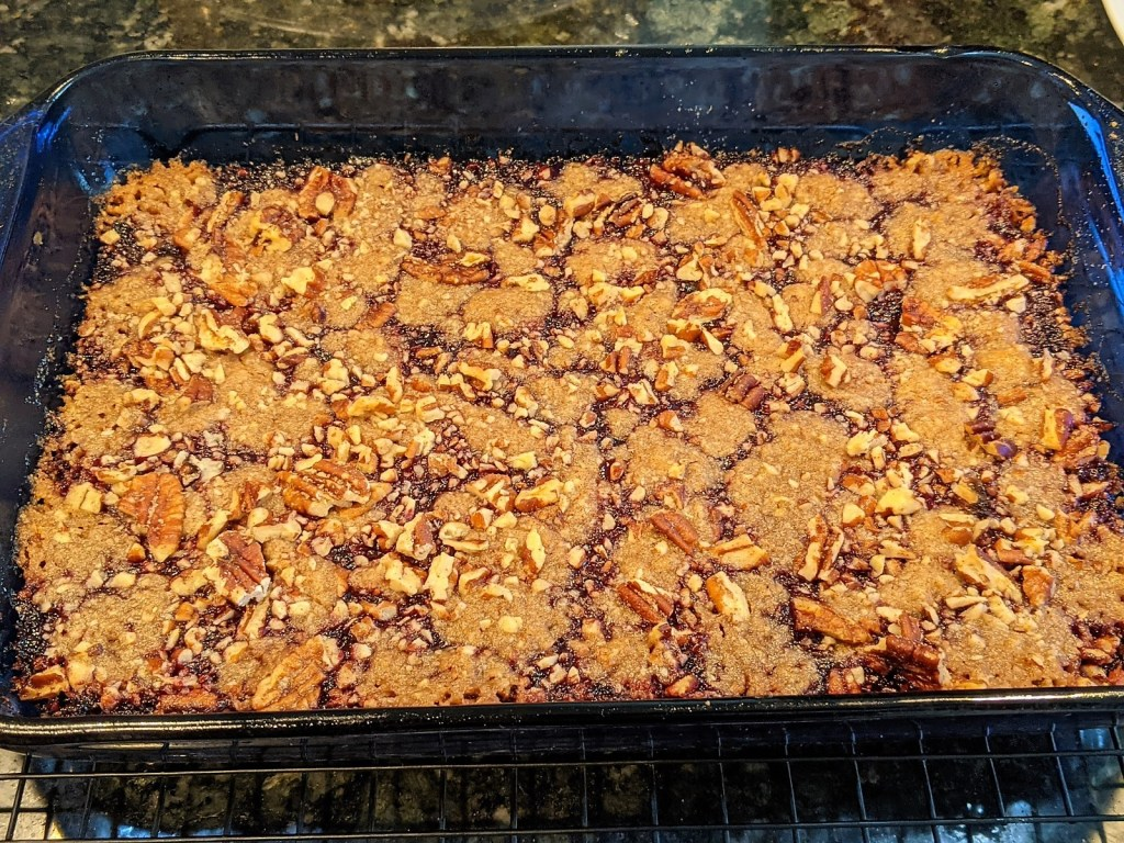 Baked bars in pan on cooling rack