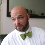 A guy, Keith, wearing a green bowtie
