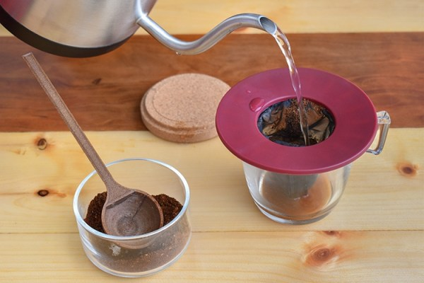 Pouring hot water into the coffee brewing apparatus