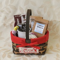 Gift basket with coffee beans, brew buddy, mug and chocolates