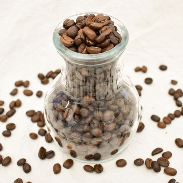 Guatemalan coffee bean in a glass container