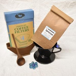 A set of coffee bean, coffee dripper cone, a box of coffee filter and 3D printed coffee filter holder