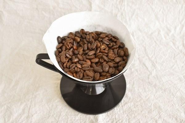 Sumatran coffee beans in a drip cone
