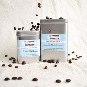 Small and large tins with coffee beans